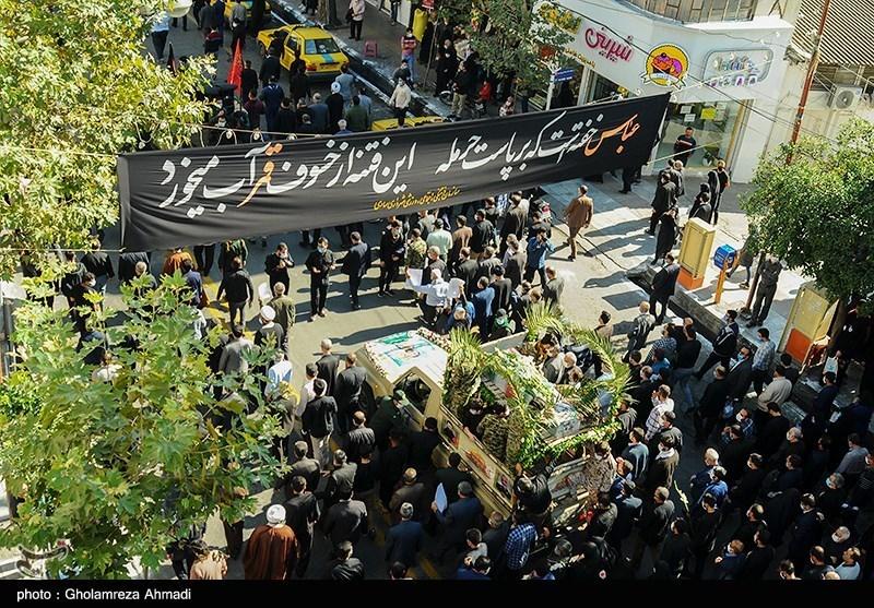 تشییع باشکوه پیکر شهید مدافع حرم در آمل / شهید حاجیزاده در جوار شهدای مدافع حرم آرام گرفت + فیلم