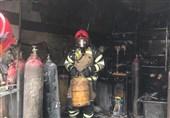 تهران  آتشسوزی در مغازه نگهداریو شارژ سیلندرهای گاز مایع + فیلم و تصاویر
