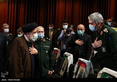 سردار علی فضلی و آیتالله سید ابراهیم رئیسی رئیس قوه قضائیه در همایش مطالبات حقوقی بینالمللی دفاع مقدس