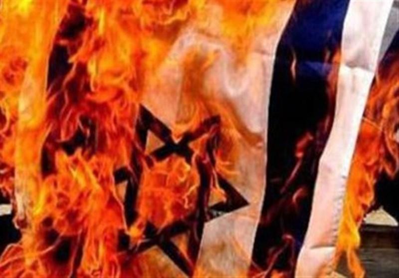 پرچم رژیم صهیونیستی همزمان با روز جهانی قدس در استان بوشهر به آتش کشیده میشود