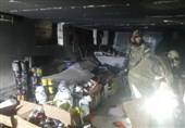 آتشسوزی در انباری نگهداری مکملهای ورزشی/ نجات یک نفر از مرگ + تصاویر
