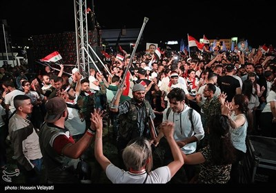 السوریون یحتفلون بفوز الرئیس الأسد بالانتخابات الرئاسیة