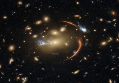 Hubble Image Shows Gravity Bending Light, Magnifying A Distant Galaxy