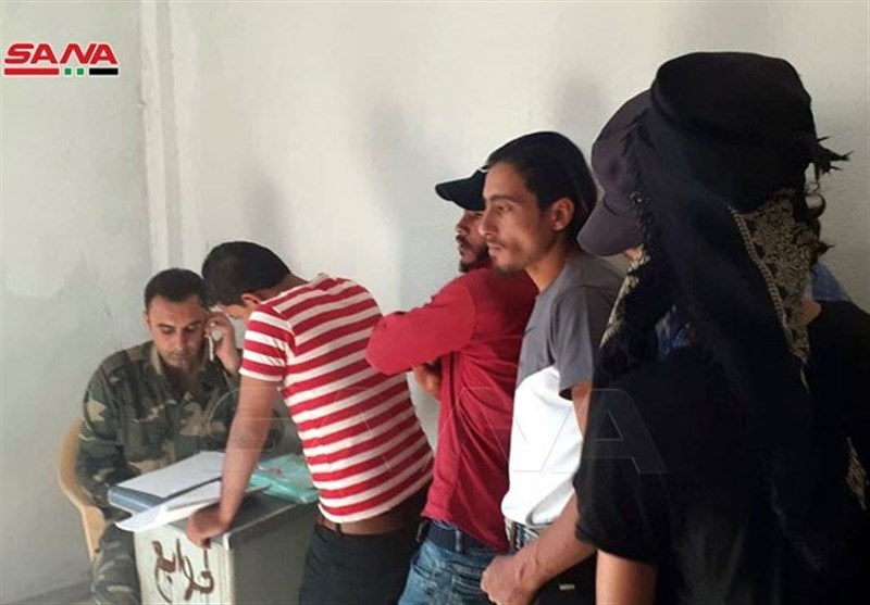 Dozens of Militants Surrender Arms to Syrian Authorities in Dara'a