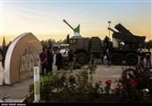 نمایشگاه هفته دفاع مقدس در کنار مزار شهدای گمنام شهرستان بهارستان اصفهان به روایت تصویر