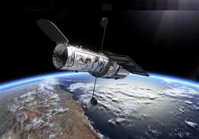 """تصویر """"تلسکوپ فضایی هابل"""" از ۲ کهکشان عظیم با نیروی گرانشی زیاد!"""